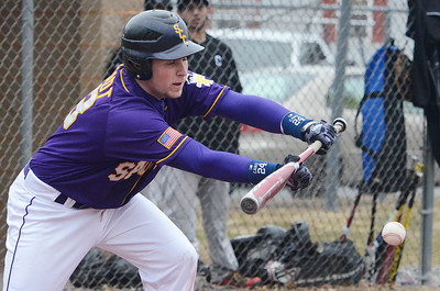 Erica Miller @togianphotog - The Saratogian:   On Monday April 7th, 2014 Saratoga Central Catholic held their first homegame against Canajoharie at the West Side Rec. Saratoga's Joe Schmidt up to bat bunting the ball.