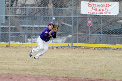 Erica Miller @togianphotog - The Saratogian:   On Monday April 7th, 2014 Saratoga Central Catholic held their first homegame against Canajoharie at the West Side Rec. Saratoga's outfielder Tim Brazzell caught the ball.