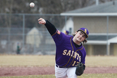 Erica Miller @togianphotog - The Saratogian:   On Monday April 7th, 2014 Saratoga Central Catholic held their first homegame against Canajoharie at the West Side Rec. Pitcher Jake Molino warmed up before the first batter was up to bat.