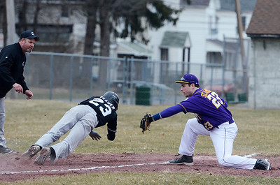 Erica Miller @togianphotog - The Saratogian:   On Monday April 7th, 2014 Saratoga Central Catholic held their first homegame against Canajoharie at the West Side Rec. Saratoga's third baseman Joe Schmidt tagged out Canajoharie's Dillan Veeder.