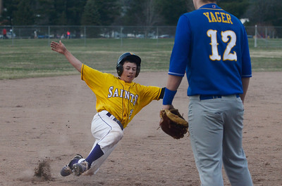 Erica Miller @togianphotog - The Saratogian:    Monday night under the lights at Veteran Memorial Park as Saratoga Central Catholic baseball held a game against Mayfield. Saratoga Central Catholic's Zack Cronk slides into third base.