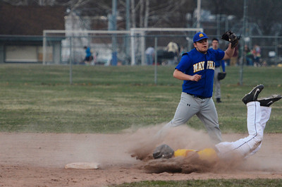 Erica Miller @togianphotog - The Saratogian:    Monday night under the lights at Veteran Memorial Park as Saratoga Central Catholic baseball held a game against Mayfield. Saratoga Central Catholic's Jake VanPatten slides into second base safely against Mayfields Austin Liar.