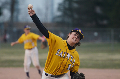 Erica Miller @togianphotog - The Saratogian:    Monday night under the lights at Veteran Memorial Park as Saratoga Central Catholic baseball held a game against Mayfield. Saratoga Central Catholic's pitcher Jake Moline warmed up before the second inning.