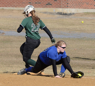 Ed Burke - The Saratogian 04/09/14 Saratoga's Meranda Ruff gets the out at first after Shen's Kelly Barkevich hit into a double play during Wednesday's game at Shen.