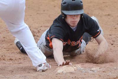 Ed Burke - The Saratogian 04/11/13 Schuylerville's Codie Brown dives back to first during Friday's game at Schuylerville against Tamarac.