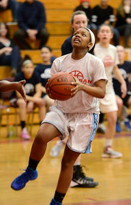 Ed Burke - The Saratogian 03/11/14 Suburban Council's Nia Moore takes aim during Tuesday's Exceptional Senior Basketball matchup against the Big Ten at Niskayuna.