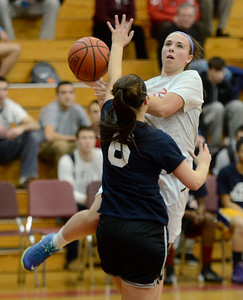 Ed Burke - The Saratogian 03/11/14 Suburban Council's Ann Mahoney shoots over Big Ten's Keely Santiago of Amsterdam during Tuesday's Exceptional Senior Basketball matchup at Niskayuna.