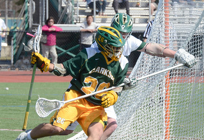 Ed Burke - The Saratogian 04/12/14 Former Blue Streak now playing for Clarkson, J.R. Campbell pushes past the long stick of Skidmore defender Jesse Evensky during Saturday's game at Skidmore.