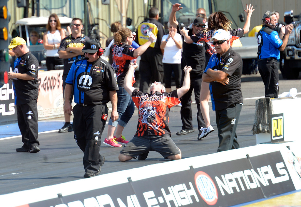 . Blake Gann drops to his knees after his son Shawn Gann defeats Hector Arana Jr. in the Pro Stock Motorcycle finals in the Mopar Mile-High NHRA Nationals July 21, 2013 at Bandimere speedway in Morrison. (Photo By John Leyba/The Denver Post)