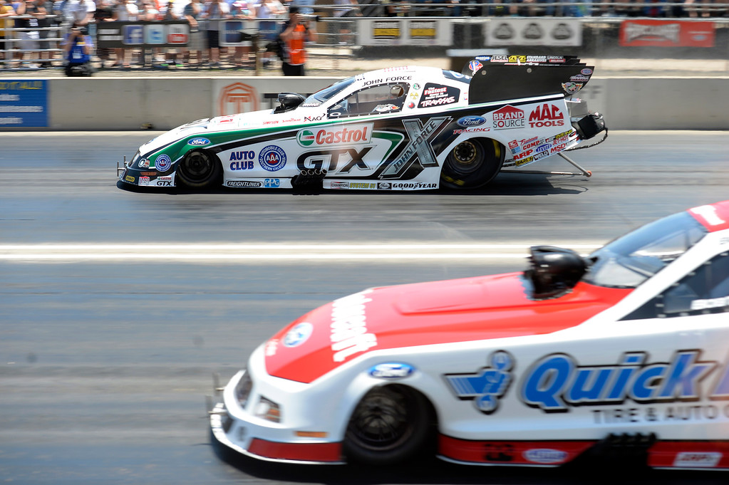 . John Force takes an early lead against Bob Tasca III during the first round of the Funny Car session at the Mopar Mile-High NHRA Nationals July 21, 2013 at Bandimere speedway in Morrison. Force lost to to Tasca. (Photo By John Leyba/The Denver Post)