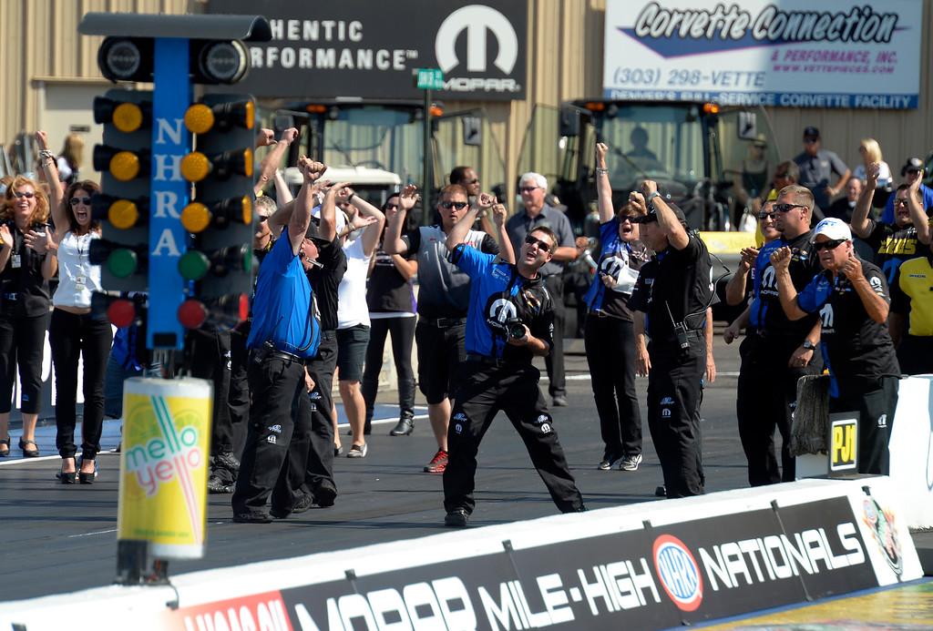 . Allen Johnson\'s crew team celebrates his win over V Gains in the Pro Stock finals in the Mopar Mile-High NHRA Nationals July 21, 2013 at Bandimere speedway in Morrison. (Photo By John Leyba/The Denver Post)
