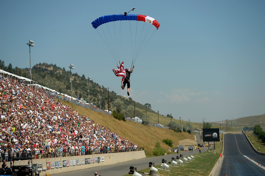 . Sky diver enters the  the speedway during the national anthem during the Mopar Mile-High NHRA Nationals July 21, 2013 at Bandimere speedway in Morrison. (Photo By John Leyba/The Denver Post)