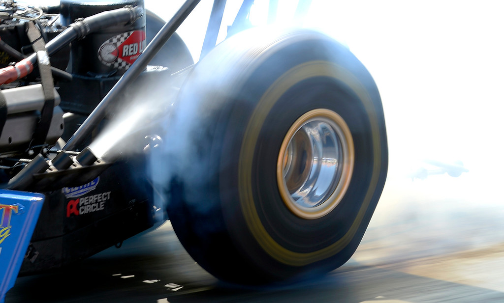 . Top Fuel burnout during the Mopar Mile-High NHRA Nationals July 21, 2013 at Bandimere speedway in Morrison. (Photo By John Leyba/The Denver Post)