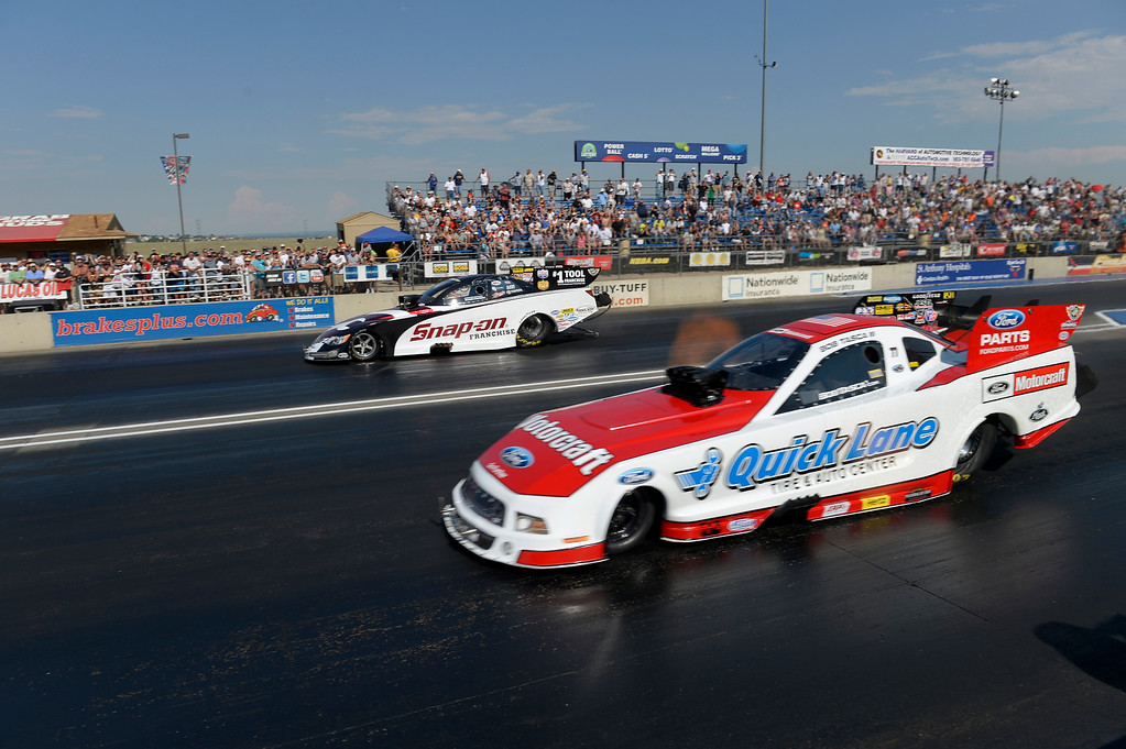 . Cruz Pedregon (L) defeats Bob Tasca III in the Funny Car Finals during the Mopar Mile-High NHRA Nationals July 21, 2013 at Bandimere speedway in Morrison. (Photo By John Leyba/The Denver Post)