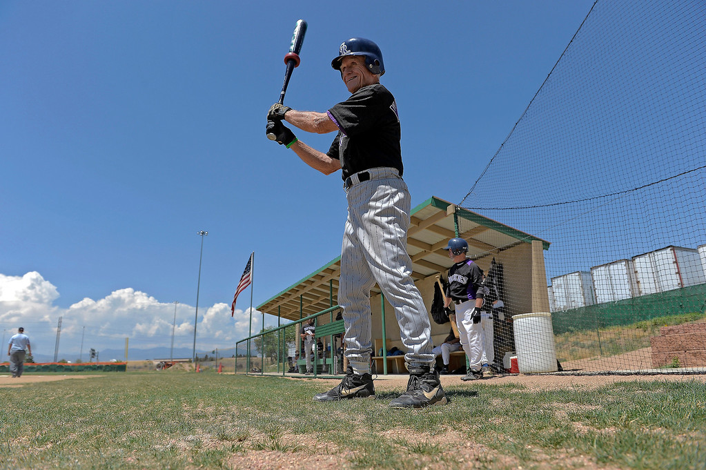 . Jack Willhite, 85, warms up in the on deck circle during their game at Mapelton Hight School on July 18, 2013. Baseball players over the age of 50 play baseball at the old Mapleton H.S field, which can be seen from the highway.  (Photo By John Leyba/The Denver Post)