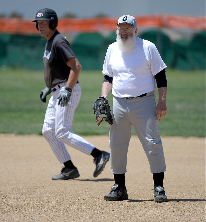 . Al Buckholtz looks on as he plays first base during their game at Mapelton High School on July 18, 2013. Baseball players over the age of 50 play baseball at the old Mapleton H.S field which can be seen from the highway.   (Photo By John Leyba/The Denver Post)