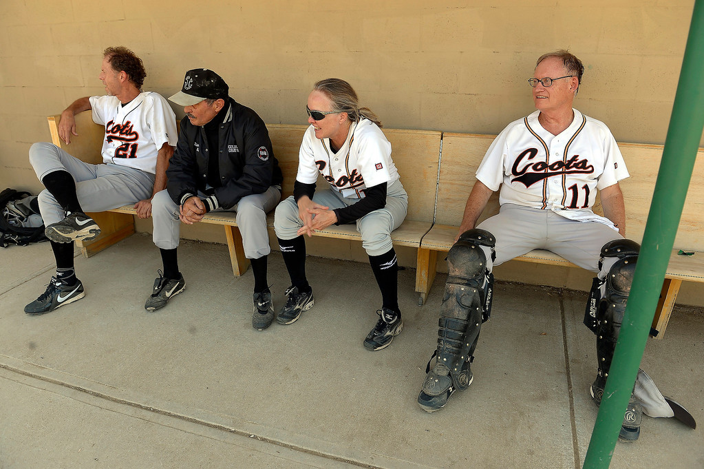 . Members of the Coots team sit in the dugout during their game on July 18, 2013. (Photo By John Leyba/The Denver Post)