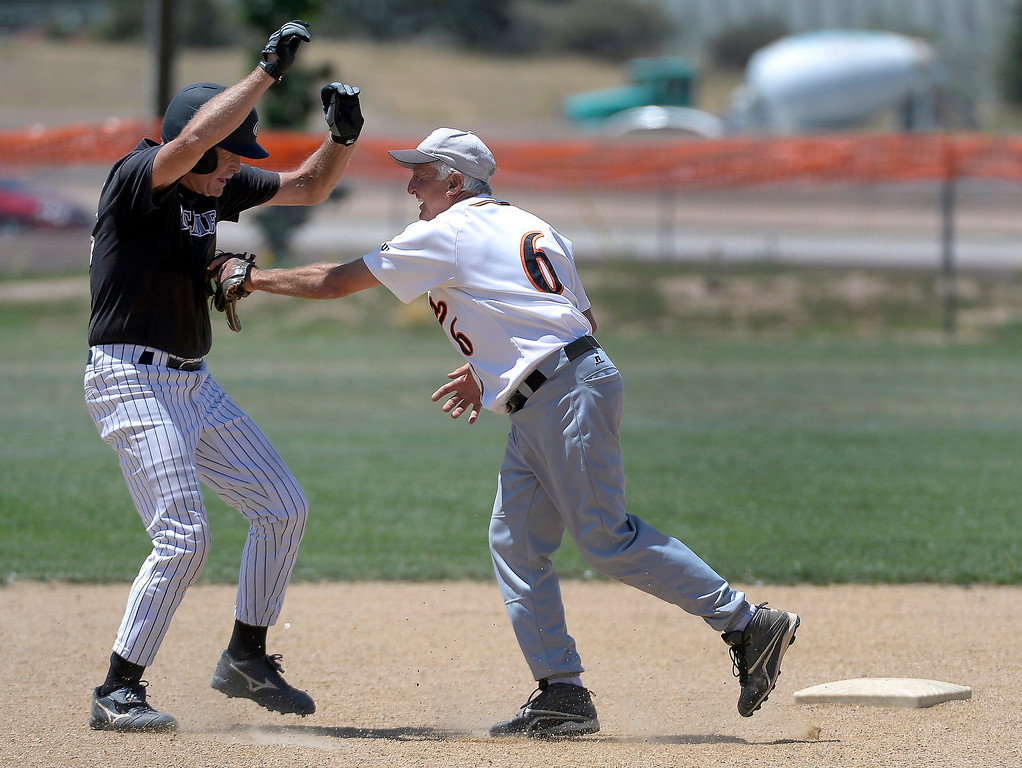 . Jerry Malberg, 65, tags out Steve Coble 68, at second base during their game at Mapelton High School on July 18, 2013.  (Photo By John Leyba/The Denver Post)