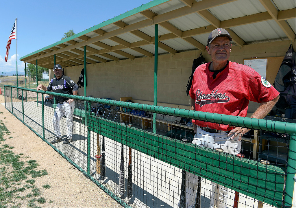 . Mark Danuser stands in the dugout as he overlooks the game on July 18, 2013 at the old Mapleton High School.  Danuser built and maintains a field for baseball players and softball players, using his own money to create the playing field and training facility in this north Denver neighborhood. (Photo By John Leyba/The Denver Post)