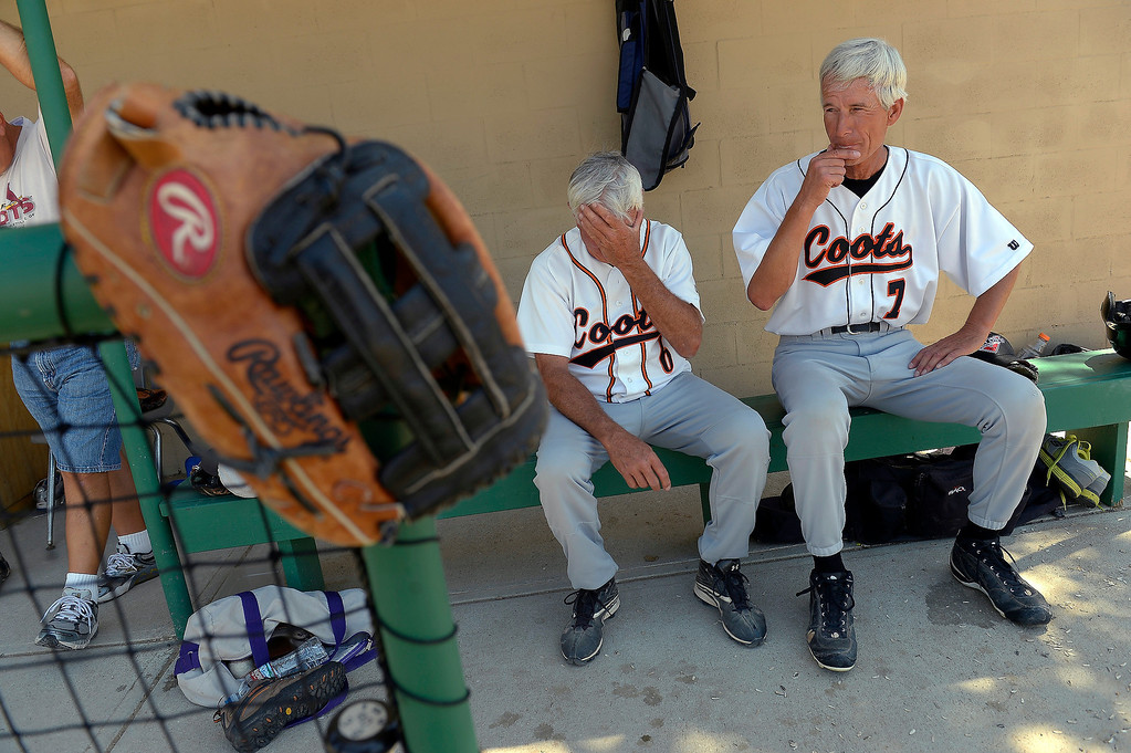 . Jerry Malberg, 65, (L) and John Damsma, 64, sit in the dugout during their game earlier in July. Baseball players over the age of 50 play baseball at the old Mapleton High School field, which can be seen from the highway.   (Photo By John Leyba/The Denver Post)