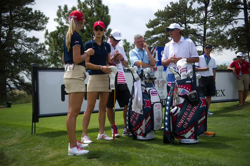 . US Team Members Michelle Wie and Jessica Korda wait to tee off on the eighteenth hole during a practice round for the Solheim Cup at the Colorado Golf Club on Tuesday, August 13, 2013. The American and European Teams practiced Tuesday morning. (Photo By Grant Hindsley/The Denver Post)