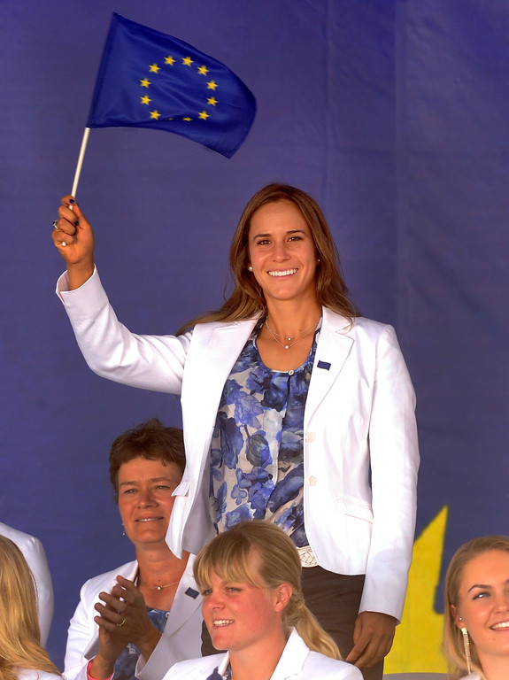 . Spanish golfer Azahara Munoz waived the European Union flag as she was introduced Thursday. Following a final practice round at the Colorado Golf Club the United States team and the team from Europe participated in opening ceremonies to being competition for the Solheim Cup Thursday evening, August 15, 2013. Photo By Karl Gehring/The Denver Post