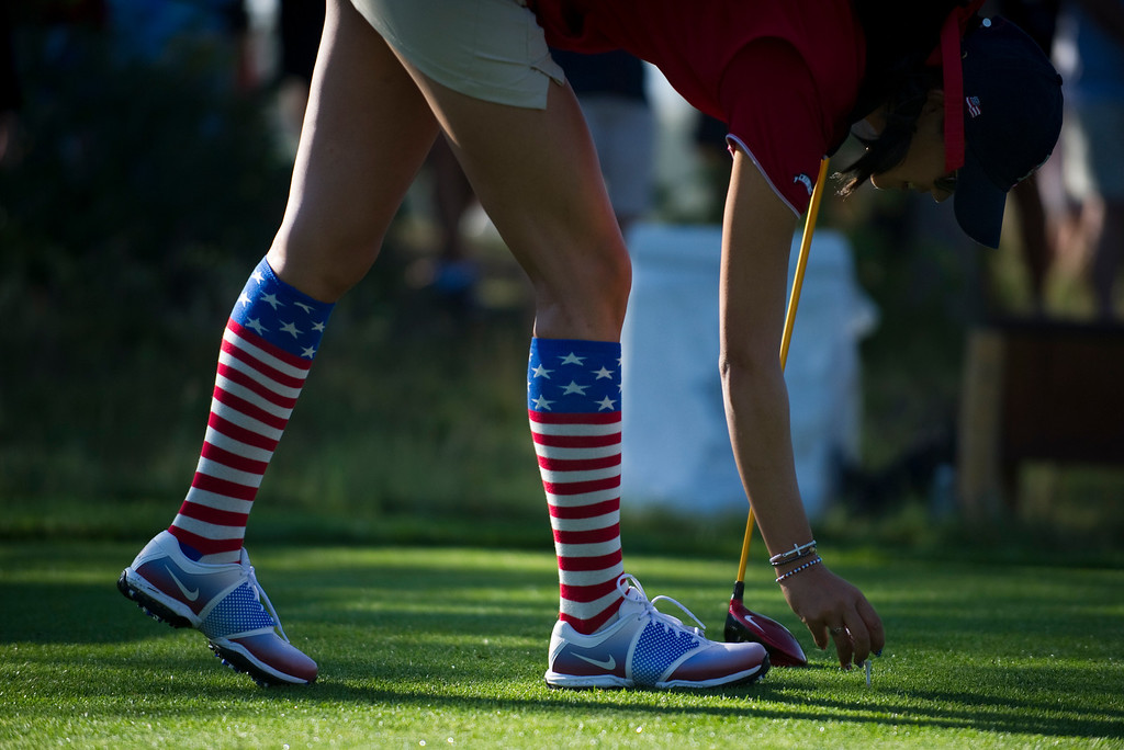 . American Michelle Wie tees her ball on the tenth hole during a practice round for the Solheim Cup at Colorado Golf Club on August 14, 2013. (Photo By Grant Hindsley/The Denver Post)