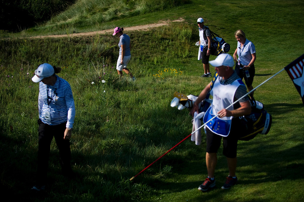. European Caroline Masson, back center, looks for a lost ball on the first hole during a practice round for the Solheim Cup at Colorado Golf Club on August 14, 2013.  (Photo By Grant Hindsley/The Denver Post)