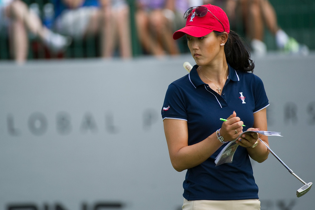 . Michelle Wie of Team USA takes notes on the fifteenth green during a practice round for the Solheim Cup at the Colorado Golf Club on Tuesday, August 13, 2013. The American and European Teams practiced Tuesday morning. (Photo By Grant Hindsley/The Denver Post)