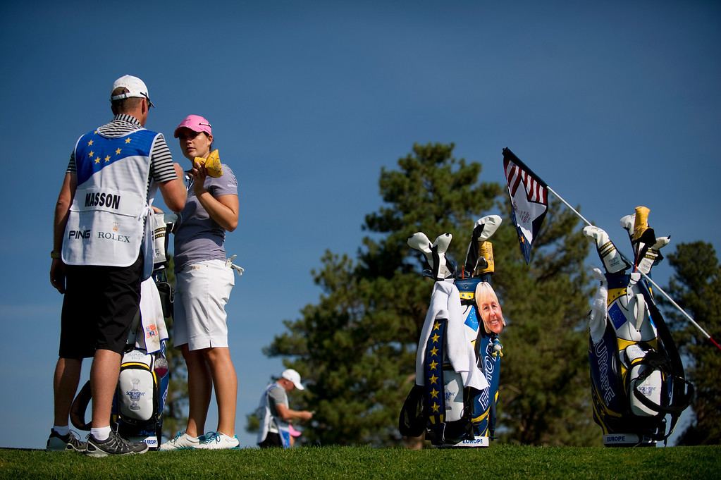 . European Caroline Masson talks with her caddy on the first green during a practice round for the Solheim Cup at Colorado Golf Club on August 14, 2013.  (Photo By Grant Hindsley/The Denver Post)