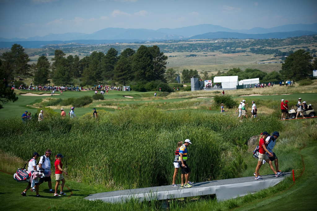 . Americans Jessica Korda, right, and Cristie Kerr, left, walk to the green on the fifteenth hole during a practice round for the Solheim Cup at Colorado Golf Club on August 14, 2013.  (Photo By Grant Hindsley/The Denver Post)
