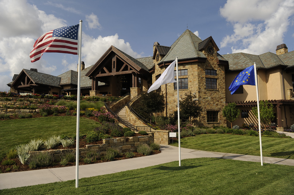 . The Stars and Stripes flew along with the Solheim Cup and the European Union flags outside the clubhouse as work continued at the Colorado Golf Club Thursday, August 8, 2013. The private course is hosting the Solheim Cup competition between American and European players next week. Photo By Karl Gehring/The Denver Post