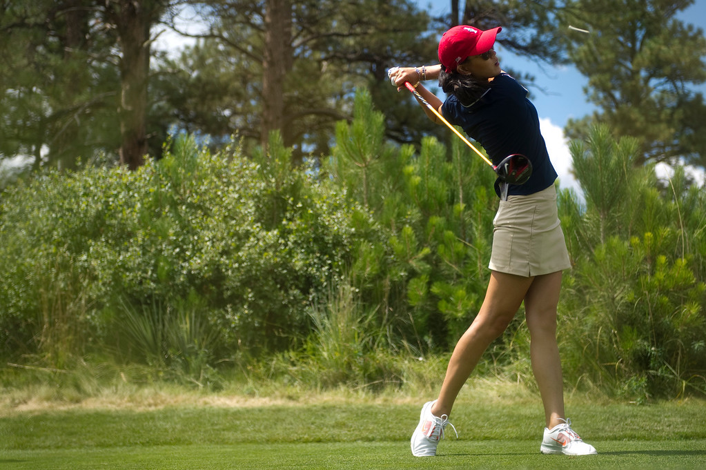 . Michelle Wie tees off on hole eighteen during a practice round for the Solheim Cup at the Colorado Golf Club on Tuesday, August 13, 2013. The American and European Teams practiced Tuesday morning. (Photo By Grant Hindsley/The Denver Post)