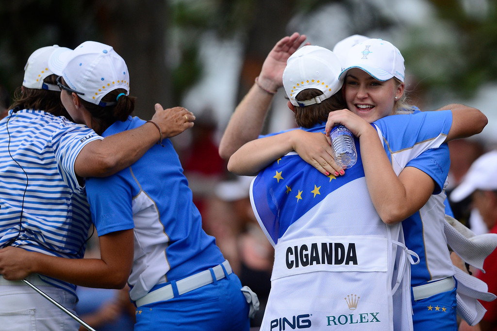 . European players react to Carlota Ciganda\'s win against Morgan Pressel, which put them within one point of winning during the final round of the Solheim Cup. A win marks the first time the Europeans have won the competition in the United States. (Photo by AAron Ontiveroz/The Denver Post)