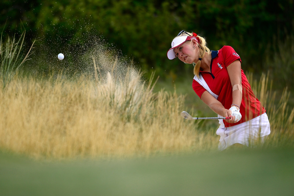 . Jessica Korda hits out of a bunker while playing against Giulia Sergas during the final round of the Solheim Cup. A win marks the first time the Europeans have won the competition in the United States. (Photo by AAron Ontiveroz/The Denver Post)