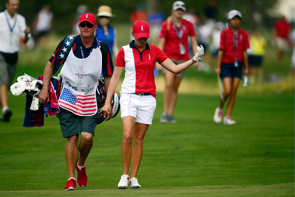 . America\'s Stacy Lewis gets the crowd going on the 16th fairway en route to a tie with Europe\'s Anna Nordqvist during the final round of the Solheim Cup. A win marks the first time the Europeans have won the competition in the United States. (Photo by AAron Ontiveroz/The Denver Post)