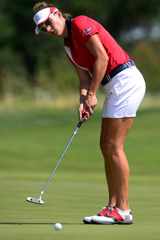 . Brittany Lang puts against Azahara Munoz during the final round of the Solheim Cup. A win marks the first time the Europeans have won the competition in the United States. (Photo by AAron Ontiveroz/The Denver Post)