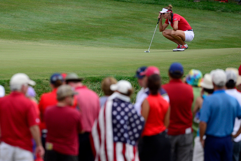 . Brittany Lang lines up her shot on the 16th hole while playing against Azahara Munoz of the European team during the final round of the Solheim Cup. A win marks the first time the Europeans have won the competition in the United States. (Photo by AAron Ontiveroz/The Denver Post)