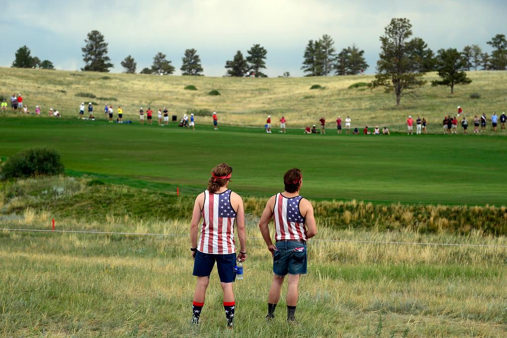 . Americans Ben Vondrehle (left) and Justin Graves watch the action on the 16th during the final round for the Solheim Cup. A win marks the first time the Europeans have won the competition in the United States. (Photo by AAron Ontiveroz/The Denver Post)