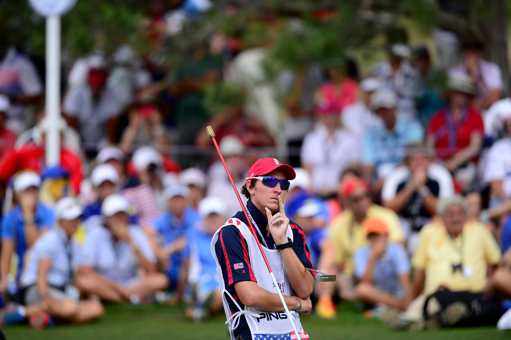 . Michelle Wie\'s caddy Duncan French reacts to the player missing a putt during the final round of the Solheim Cup. A win marks the first time the Europeans have won the competition in the United States. (Photo by AAron Ontiveroz/The Denver Post)