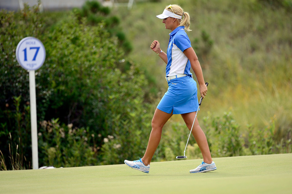 . Europe\'s Anna Nordqvist pumps her fist after going all even with Stacy Lewis on the 17th during the final round of the Solheim Cup. A win marks the first time the Europeans have won the competition in the United States. (Photo by AAron Ontiveroz/The Denver Post)