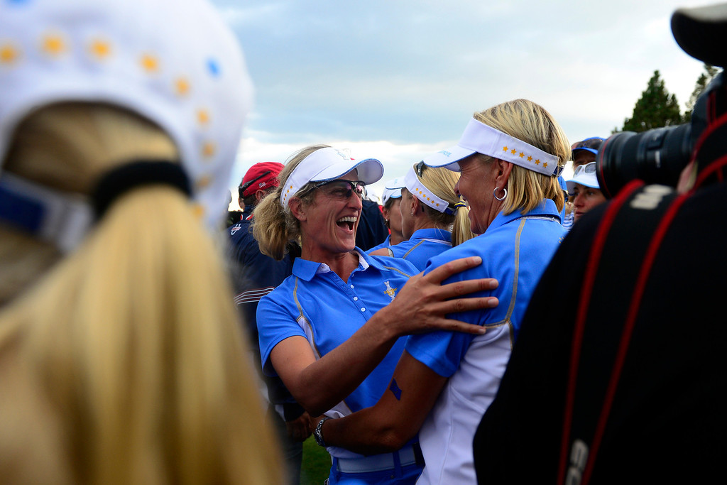 . PARKER, CO - AUGUST 18: Giulia Sergas celebrates with teammates following the final round of the Solheim Cup. WIth their win, the Europeans captured their first cup in the United States. (Photo by AAron Ontiveroz/The Denver Post)
