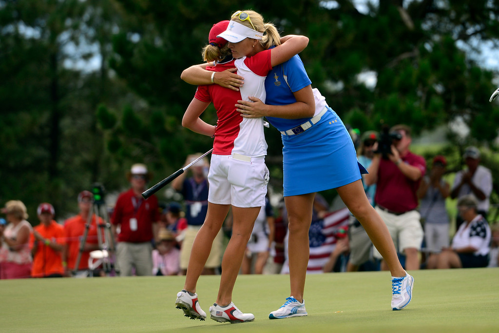. Stacy Lewis hugs Anna Nordqvist on the 18th during the final round for the Solheim Cup. A win marks the first time the Europeans have won the competition in the United States. (Photo by AAron Ontiveroz/The Denver Post)