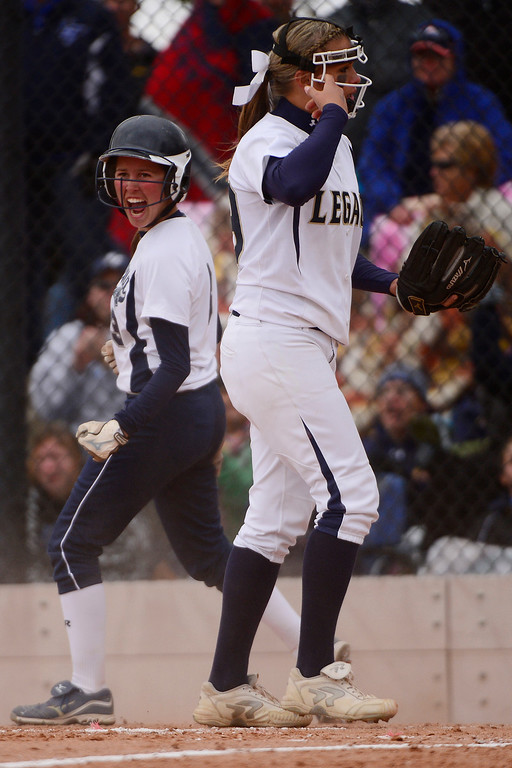 . Legend\'s Steph Cardona celebrates the game\'s opening run as Legacy pitcher Haley Smith reacts during the Lightning\'s 6-4 state title win at the Aurora Sports Park on Sunday, October 20, 2013. The win was Legacy\'s sixth title in seven years. (Photo by AAron Ontiveroz/The Denver Post)