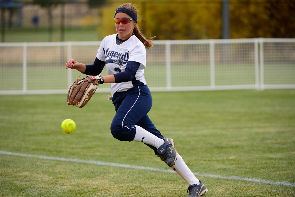 . Legend\'s Steph Cardona runs down a foul ball against Legacy during the Legacy\'s 6-4 state title win at the Aurora Sports Park on Sunday, October 20, 2013. The win was Legacy\'s sixth title in seven years. (Photo by AAron Ontiveroz/The Denver Post)