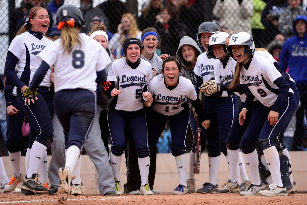 . Teammates celebrate at home plate after Legend\'s Karlee Arnold hit a three-run home run in the top of the seventh inning against Legacy during Legacy\'s 6-4 state title win at the Aurora Sports Park on Sunday, October 20, 2013. The win was Legacy\'s sixth title in seven years. (Photo by AAron Ontiveroz/The Denver Post)