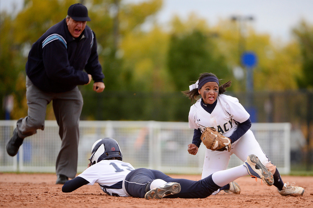 . Legacy Celyn Whitt (21) reacts to tagging out Legend\'s Zoe Mihalicz during the Legacy\'s 6-4 state title win at the Aurora Sports Park on Sunday, October 20, 2013. The win was Legacy\'s sixth title in seven years. (Photo by AAron Ontiveroz/The Denver Post)