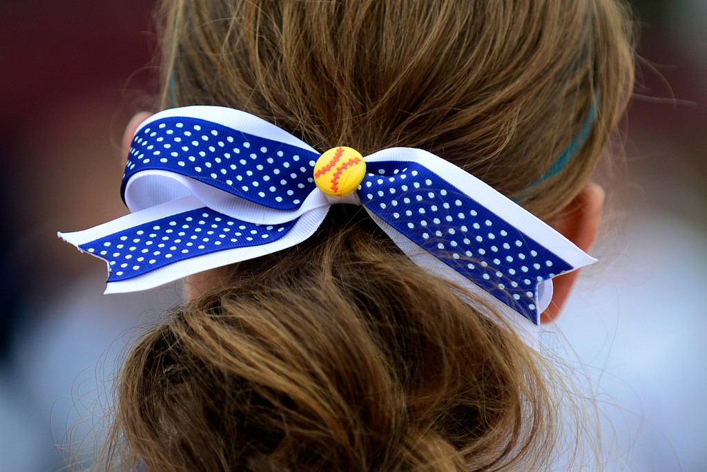 . Legend\'s Brittney Russo wears a softball-themed ribbon in her hair during Legacy\'s 6-4 state title win at the Aurora Sports Park on Sunday, October 20, 2013. The win was Legacy\'s sixth title in seven years. (Photo by AAron Ontiveroz/The Denver Post)
