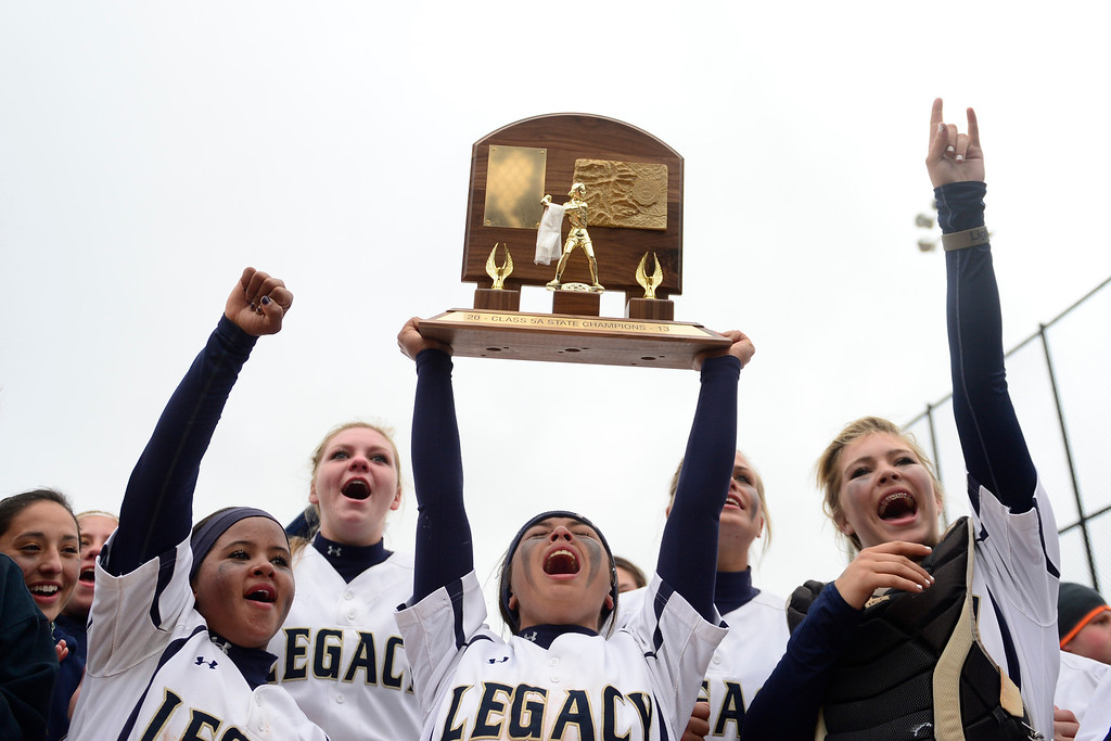 . Aspen Eubanks of the Legacy hoists the team\'s trophy following the Legacy\'s 6-4 state title win at the Aurora Sports Park on Sunday, October 20, 2013. The win was Legacy\'s sixth title in seven years. (Photo by AAron Ontiveroz/The Denver Post)