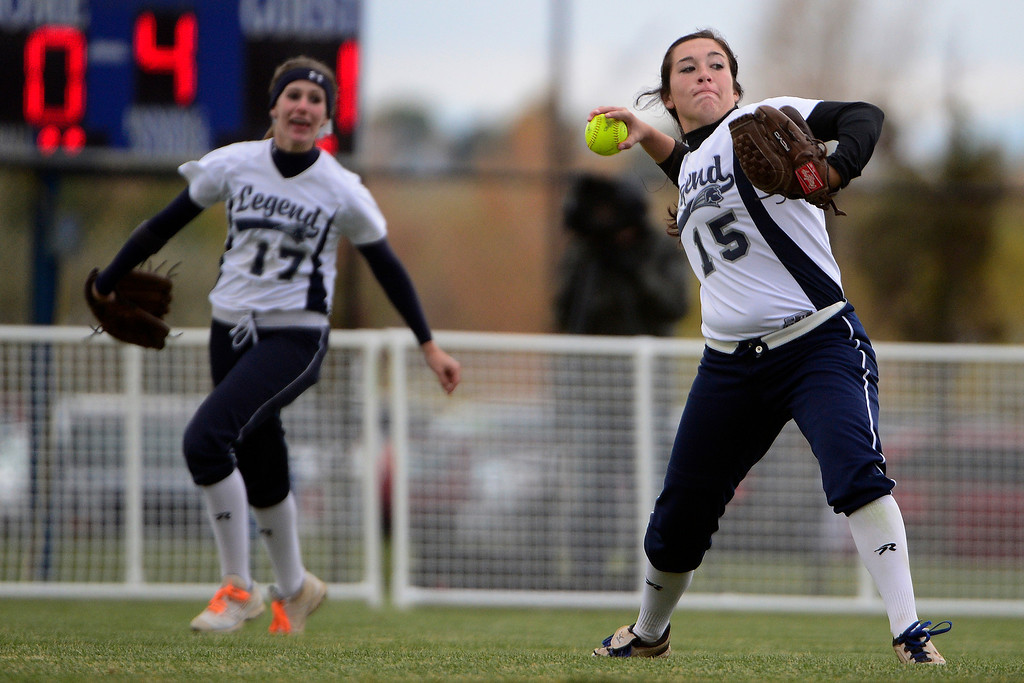 . Legend\'s Kaley Garcia fields a ball against Legacy during Legacy\'s 6-4 state title win at the Aurora Sports Park on Sunday, October 20, 2013. The win was Legacy\'s sixth title in seven years. (Photo by AAron Ontiveroz/The Denver Post)